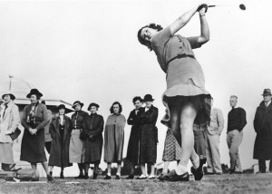 Babe Didrickson Zaharias drives the golf ball.