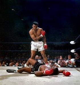 Ali after felling Liston, 1965