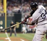 Ortiz can generate more power with his swing because he does not have to come over the ball with his trailing (left) arm.